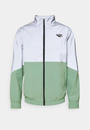 MELVIN COLOURBLOCK REFLECTIVE TRACK JACKET - Training jacket - granite green