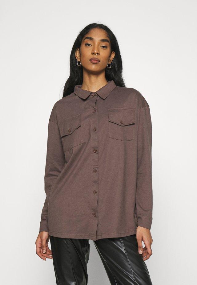 POCKET DETAIL - Button-down blouse - brown
