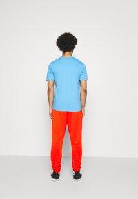 Jordan - PANT - Tracksuit bottoms - chile red/black - 2