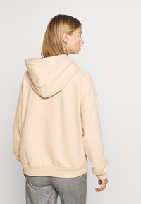 Levi's® - GRAPHIC HOODIE - Hoodie - toasted almond