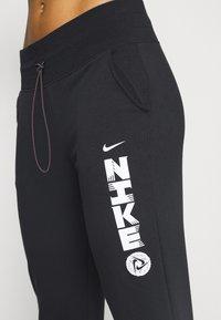 Nike Performance - Pantalones deportivos - black/white - 4