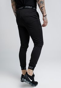 SIKSILK - PERSUIT PANT - Tracksuit bottoms - black - 2