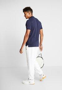 Nike Performance - PANT HERITAGE - Tracksuit bottoms - white - 2