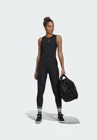adidas by Stella McCartney - SUPPORT CORE  - Sports shirt - black - 1