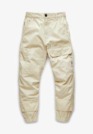 TAPERED - Trousers - ecru