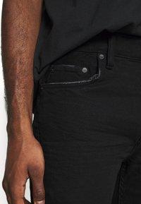 AllSaints - CIGARETTE  - Slim fit jeans - black - 4