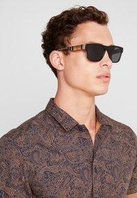 Burberry - Sunglasses - black - 1