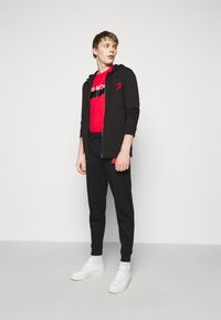 HUGO - DEASTY - Pantaloni sportivi - black - 1