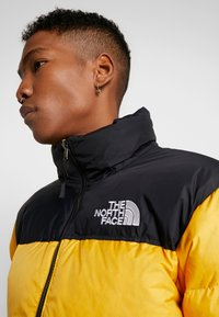 The North Face - Down jacket - yellow - 4