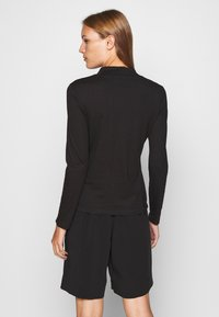 Calvin Klein - LIQUID TOUCH TURTLE NECK - Long sleeved top - black - 2