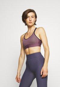 Under Armour - INFINITY MID BRA - Medium support sports bra - purple/black - 0