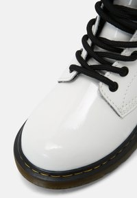 Dr. Martens - 1460 J - Lace-up ankle boots - white patent lamper - 4