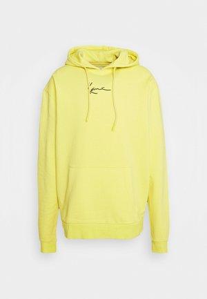 SIGNATURE WASHED HOODIE UNISEX - Collegepaita - light yellow