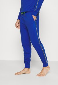 Diesel - UMLB-PETER TROUSERS - Pyjama bottoms - blue - 0