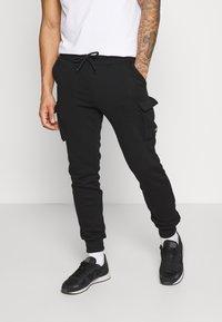 YOURTURN - UNISEX - Pantalon de survêtement - black - 0