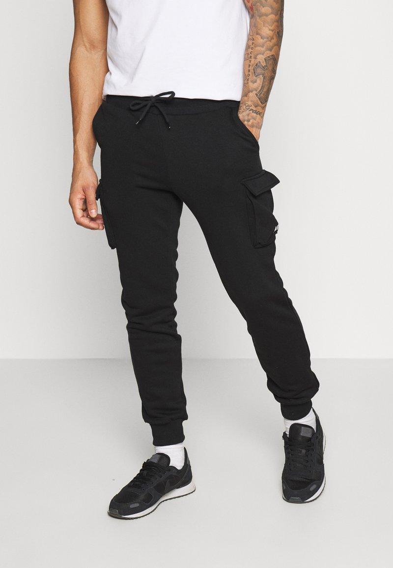 YOURTURN - UNISEX - Pantalon de survêtement - black