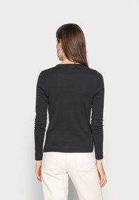 Levi's® - BABY TEE - Long sleeved top - black - 2