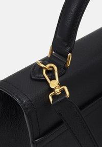 Bally - CHAIN TO HANDLE BAG - Handbag - black - 4
