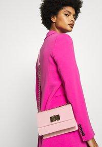 Furla - MINI CROSSBODY - Across body bag - rosa chiaro - 1