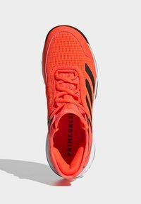 adidas Performance - UBERSONIC 4 K - Multicourt tennis shoes - orange - 3