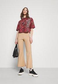 Puma - BOYFRIEND TEE - Print T-shirt - apricot blush - 1