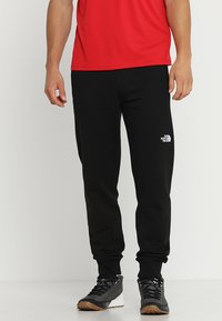 The North Face - LIGHT PANT  URBAN - Spodnie treningowe - black/white - 0