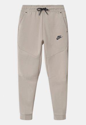 Pantalones deportivos - desert sand