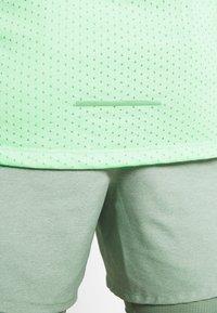 Nike Performance - RISE TANK - Sports shirt - pistachio frost - 5