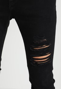 Jack & Jones - JJILIAM JJORIGINAL - Vaqueros pitillo - black denim - 4