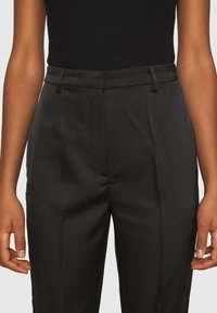 NA-KD - STRAIGHT SUIT PANTS - Trousers - black - 4