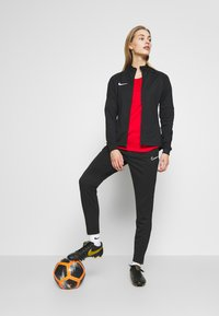 Nike Performance - DRY ACADEMY SUIT - Tracksuit - black - 1
