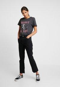 Tommy Jeans - CROP FLARE - Flared Jeans - black denim - 1