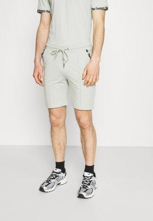 FLOCK DETAIL - Shorts - sage green