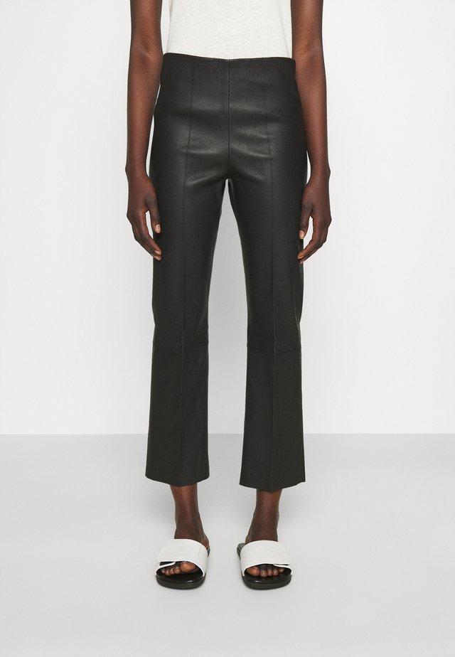 FLORENTINA - Leather trousers - black