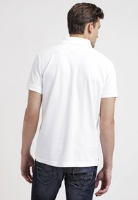 Tommy Hilfiger - PERFORMANCE REGULAR FIT - Polo shirt - white - 2