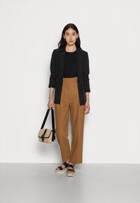 Selected Femme - SLFLEVA PANT - Trousers - rubber - 1
