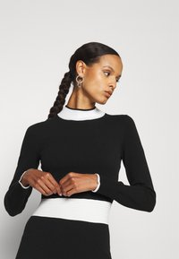 HUGO - SUMERY - Obleka/pulover - black - 3