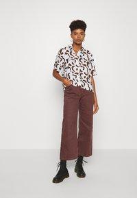 Monki - BITTY BLOUSE - Button-down blouse - offwhite/light blue - 1