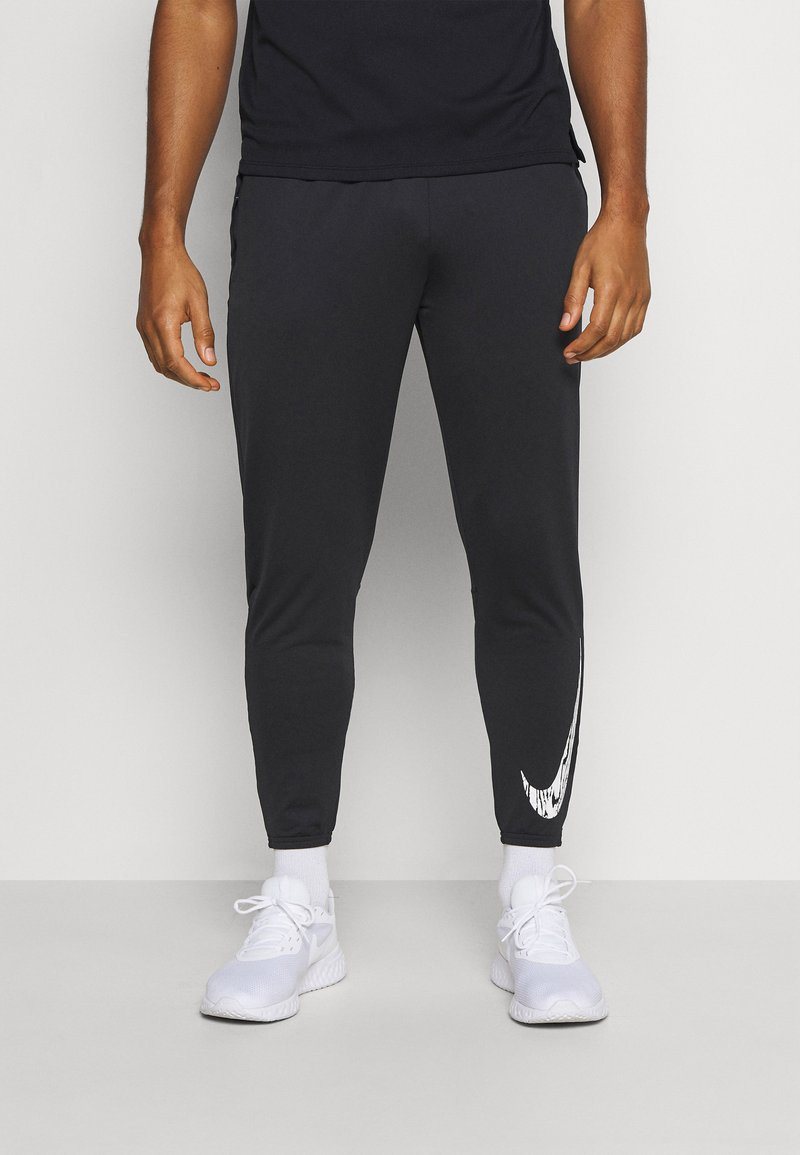 Nike Performance - ESSENTIAL PANT - Pantalones deportivos - black/reflective silver
