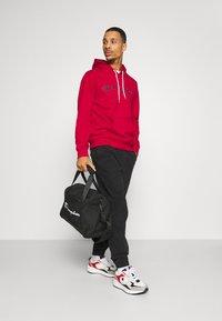 Champion - LEGACY XS DUFFEL - Sports bag - black - 0