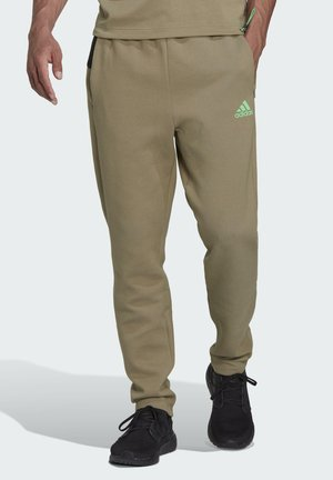 M ZNE - Tracksuit bottoms - green