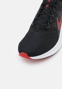 Nike Performance - DOWNSHIFTER 11 - Neutral running shoes - black/university red/white/dark smoke grey - 5