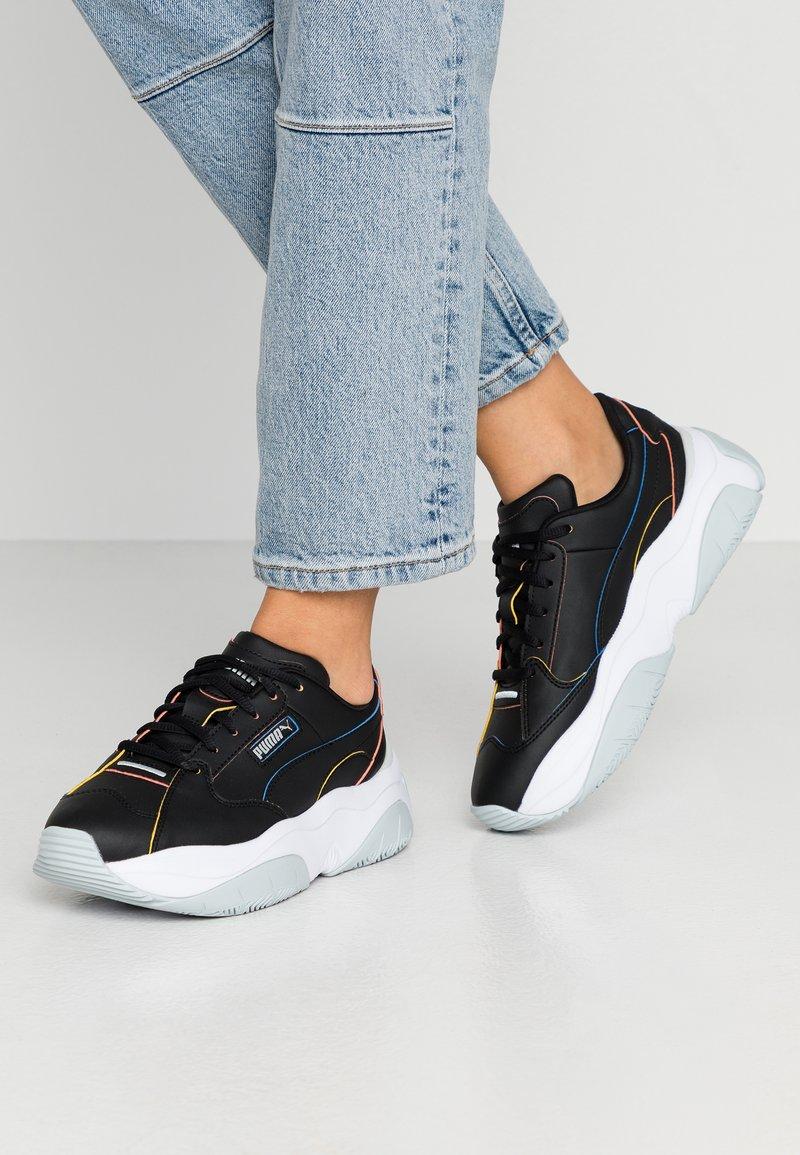 Puma - STORM.Y POP - Sneakersy niskie - black