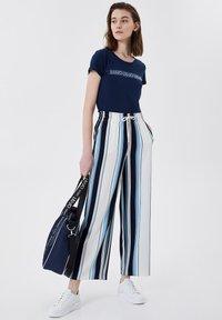 LIU JO - Trousers - stripes/blue - 1