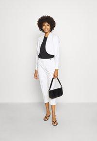 comma - Pantalon classique - white - 1