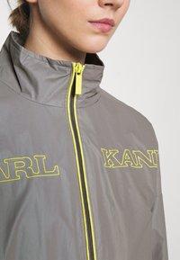 Karl Kani - RETRO SHINY SHORT TRACKJACKET - Summer jacket - grey - 4