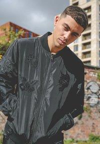 Ed Hardy - DRAG-CLOUD NYLON BOMBER JACKET - Summer jacket - black - 5