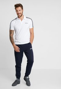 adidas Performance - Tracksuit bottoms - legend ink/white - 1