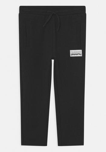 DUO PANTS UNISEX - Tracksuit bottoms - black