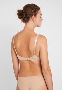 Triumph - TRUE SHAPE SENSATION - T-shirt bra - smooth skin - 2